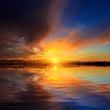 Sunset scene over lake water surface Stock Photo