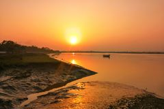 Sunset scene on the river bank, Sunbeam, Small boats, Reflection royalty free stock image