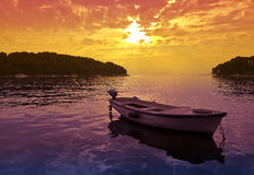 Sunset scene with a small boat Royalty Free Stock Photo
