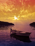 Sunset scene with small boat Royalty Free Stock Image
