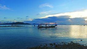 Sunset scene of traditional fisherman long tailed stock footage