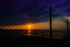 Sunset Scenery Through The Fence Stock Photos