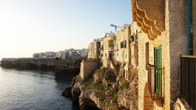Sunset scenery with overhanging old town of Polignano a mare on cliffs rocks on Mediterranean sea, Apulia, Italy Royalty Free Stock Photo