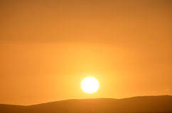 Sunset in Scotland. Sunrise over a hillside in Scotland royalty free stock photos