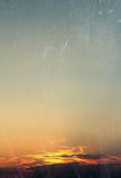 Sunset on scratched glass Stock Image