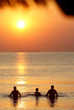Sunset sea. Family enjoying the sunset in the sea stock photos