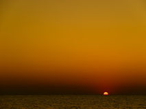 Sunset on the sea. Sunset in orange colours on the sea Stock Image