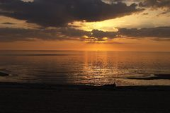 Sunset on the sea. Sunset, sea, water, evening, reflections, sand Royalty Free Stock Photography