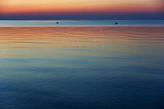 Sunset on sea Stock Images
