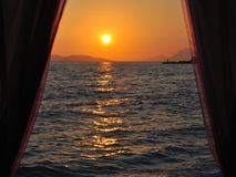 Sunset at adriatic sea across the curtain Royalty Free Stock Photo