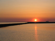 Sunset by the sea stock photography