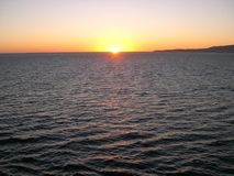 Sunset at Sea. Sunsetting n the ocean while at sea. peaceful, calm, quiet Royalty Free Stock Photos