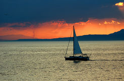 Sunset at sea. With yaht stock images