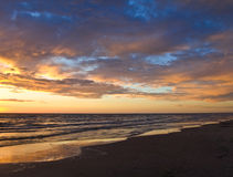 Sunset on the sea. Sunset on the baltic beach Stock Images