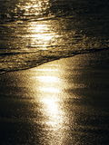 Sunset On Sea. Sun going down shining on the sea Stock Photo