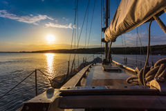Sunset at sea on aboard Yacht Sailing Stock Photos
