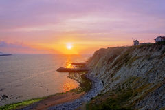 Sunset on the sea with Aixerrota mill Stock Photo