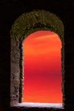 Sunset sea ancient window Royalty Free Stock Photos