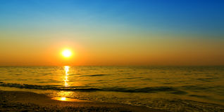 Sunset on by sea background natural Stock Photos