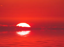 Sunset sea background. Nature sunset background: sun, clouds and the sea surface with waves Stock Photos