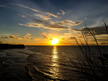Sunset by the Sea in Bali Island Royalty Free Stock Photo
