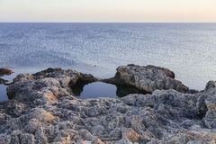 Sunset in the sea bay with rocks Royalty Free Stock Photos