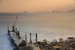 Sunset at a sea beach with beautiful sky Royalty Free Stock Photos