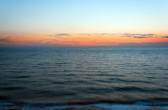 Sunset at sea beach blue sky Stock Images