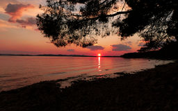 Sunset. By the sea on the beach in Croatia Stock Photography