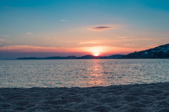 Sunset by the sea at the beach in Mykonos Royalty Free Stock Image