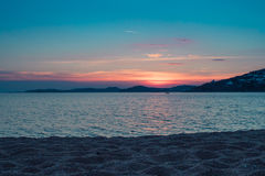 Sunset by the sea at the beach in Mykonos Stock Photography
