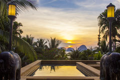 Sunset sea beach pool. Sunset light reflects in the resort pool at Krabi province, Thailand Royalty Free Stock Photography