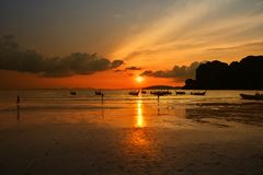 Free Sunset Sea Beach With Long Tail Boat Silhouettes Royalty Free Stock Photography - 113813717