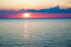 Sunset in the sea and beautiful cloudscape stock photography