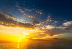 Sunset at sea. Beautiful sunset at the sea and motion blur cloud on sky Royalty Free Stock Images
