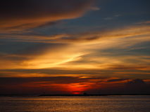 Sunset at the sea. Beautiful sunset and nice cloud Stock Photography