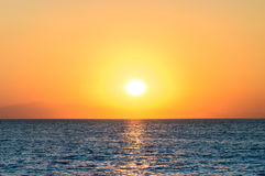 Sunset in the sea Stock Images