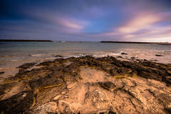 Sunset on sea. Beautiful violet sky meets sea on sunset royalty free stock photography