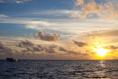 Sunset. At sea and boat Stock Photo