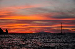 Sunset on the sea with boat, Giglio Island, Tuscany Italy. Dusk on the sea with boat, Giglio Island, Tuscany Italy Royalty Free Stock Image