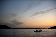Sunset on the sea with a boat Stock Photography