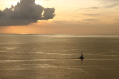 Sunset sea with boat. When sunset at phuket thailand Royalty Free Stock Images