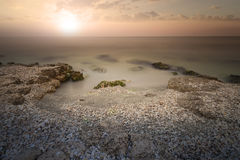 Sunset on sea. Bright sun on sky. Royalty Free Stock Photo