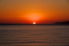 Sunset on sea. Bright sun on sky Royalty Free Stock Photos