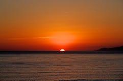 Sunset on sea. Bright sun on sky Stock Photography