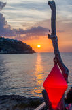 Sunset on the sea with a buoy Royalty Free Stock Photo