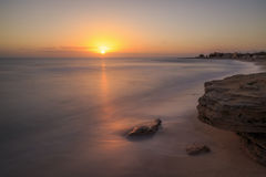 Sunset. Sea, calm, serenity, peace, tranquility, relaxation, meditation, sand, beach, rock, dusk, sunset, waves, flat, Salento, southern Italy, Puglia, holidays Royalty Free Stock Images