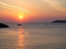 Sunset, Sea, Cliffs, And Little Yacht Royalty Free Stock Images