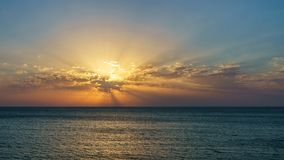 Sunset on the sea in the clouds with sun rays. On azov Stock Photography