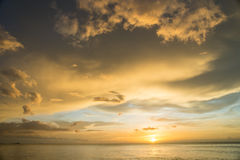 Sunset on the sea with cloudy sky background Royalty Free Stock Photo